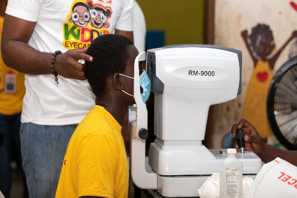 A beneficiary undergoing free eye test