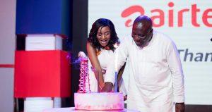 CEO-of-AirtelTigo-Mrs-Mitwa-Kaemba-Ng%u2019ambi-and-Deputy-Minister-of-Communications-Vincent-Sowah-Odotei-cutting-the-anniversary-cake-1-1024x543